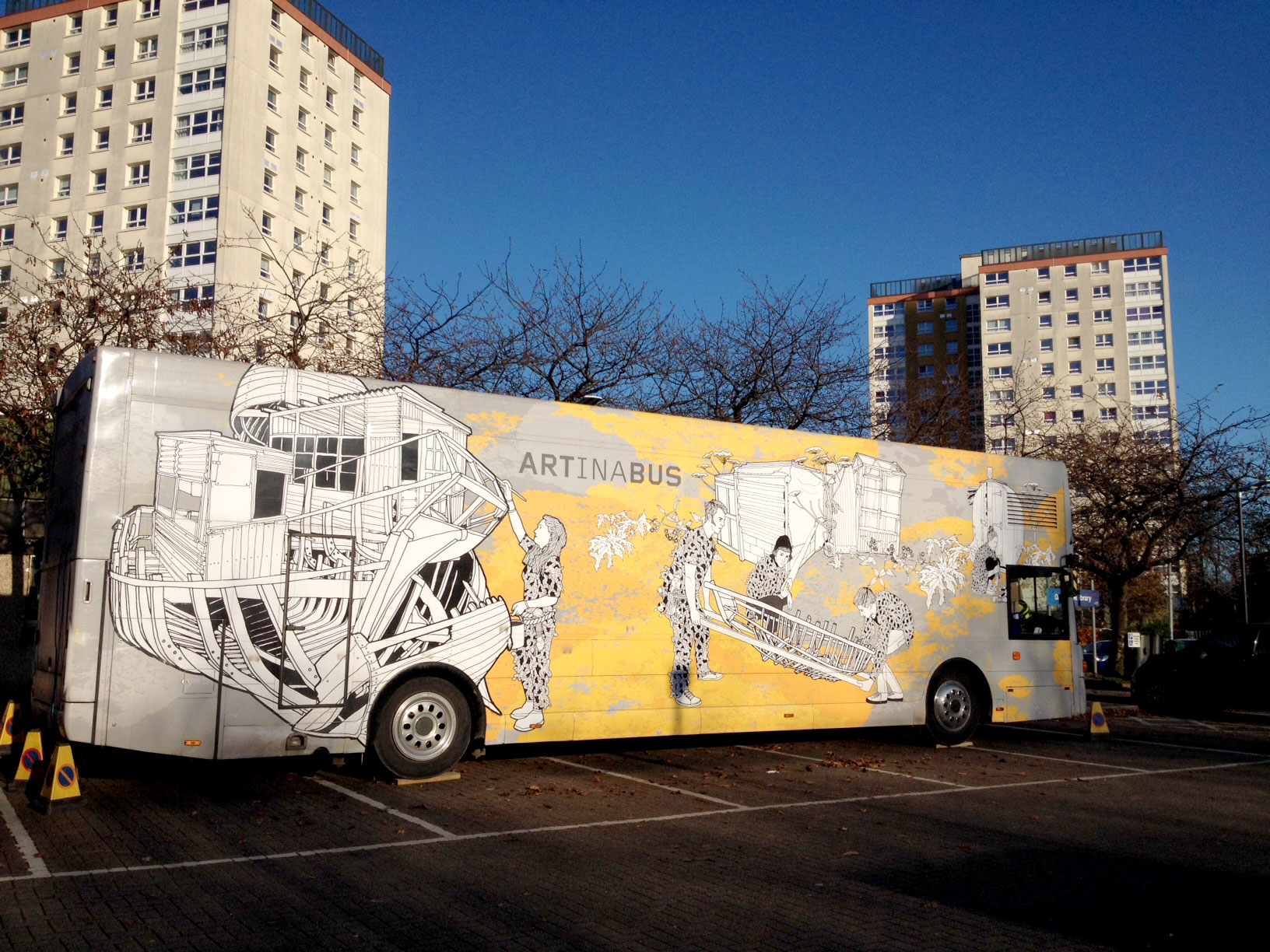 Travelling Gallery in front of high flats