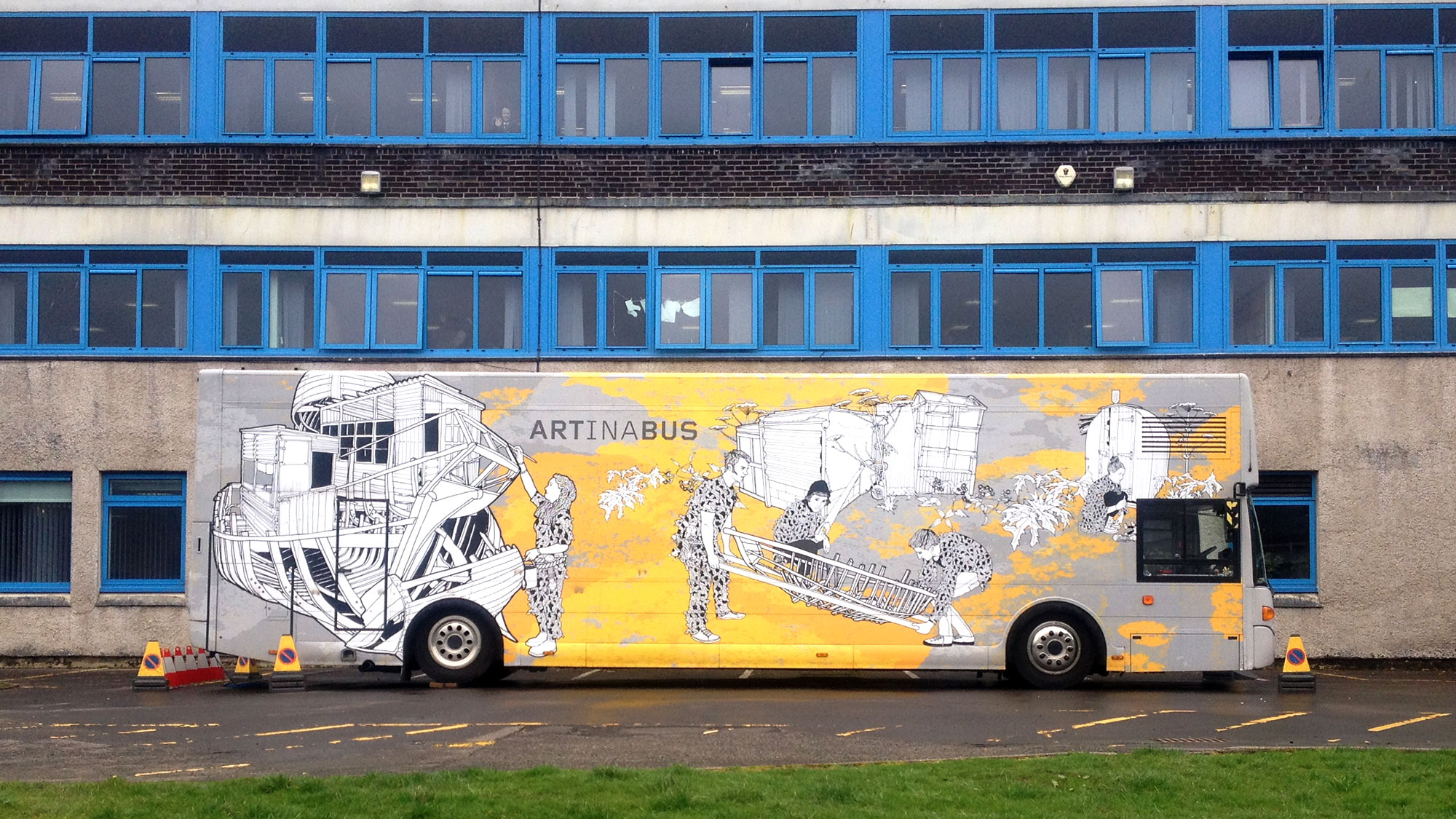 Travelling Gallery parked in front of large secondary school